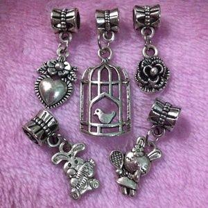 Jewelry - Bunny, flower, bird in crane dangle charm set