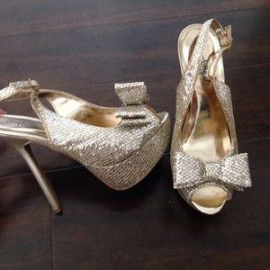 Gold metallic bow tie heels