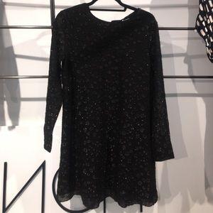 Shiny black long sleeve dress