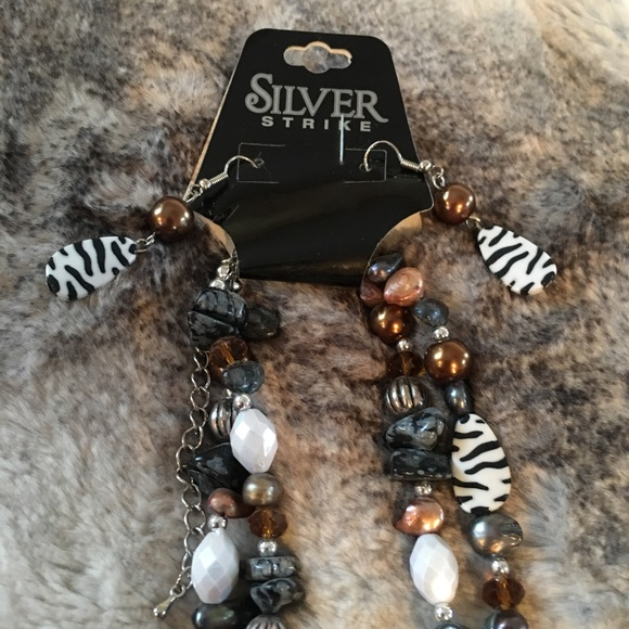 9130f232ba silver strike Jewelry | Brown And Zebra Necklace | Poshmark