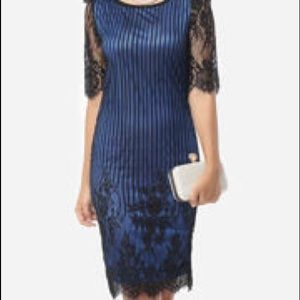Dresses & Skirts - Sexy blue dress with black lace detail.
