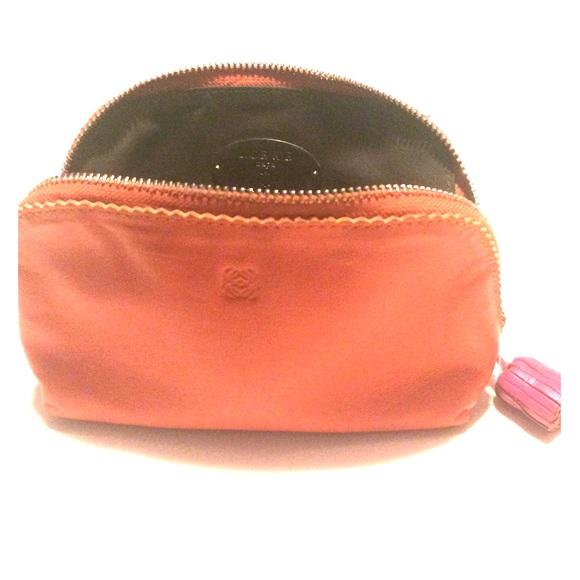 Loewe Handbags - Loewe clutch bag in orange. EUC