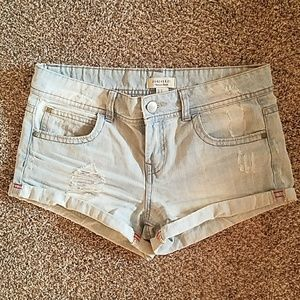 Light blue distressed shorts