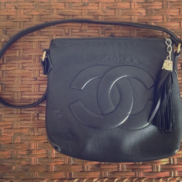 c69c02422d0770 CHANEL Handbags - Vintage CHANEL leather bag with tassel