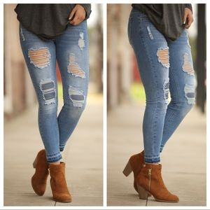 Medium wash destroyed denim skinny jeans