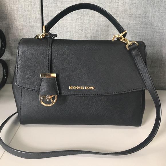 307b5cf5fd1d ... Ava Medium Saffiano Leather Satchel Black. M_597b6435f0137d051b02a2e6.  Other Bags you may like. MICHAEL KORS GROMMET BAG