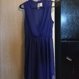Blue dress with gold detailing.