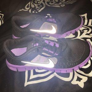 Nike free run 3. Purple and black tennis shoes