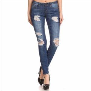 Distressed skinny jeans medium dark wash
