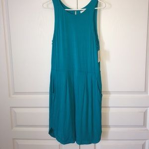 Stretchy Teal dress with side pockets