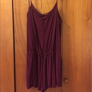 Plum romper with criss-cross detail