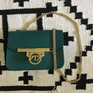 Green leather and gold crossbody with chain