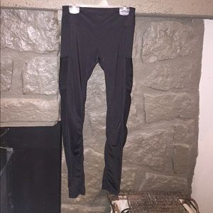Pants - Black workout leggings with pockets and mesh.
