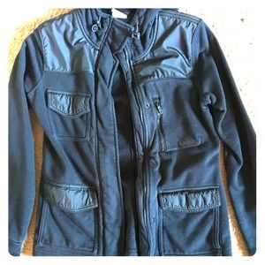 Nike XS zip up jacket. Black in color.