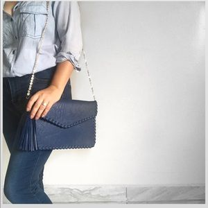 Blue clutch with tassel