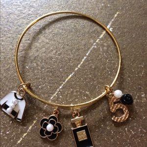 Handcrafted charm gold bracelet