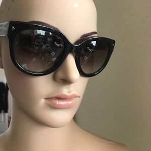 c4b06df184 ... australia prada accessories prada swing cat eye sunglasses b0c2a 08ce0