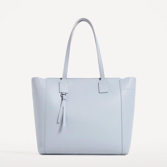 8ae975f0365 Zara Faux Leather Light Blue Tote Bag. M_5983a1e58f0fc46be00029e2