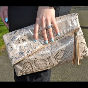 Metallic snake print clutch