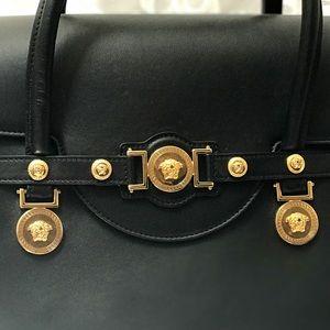 9732e9317720 Versace Bags - Versace Signature Lock Leather Handbag