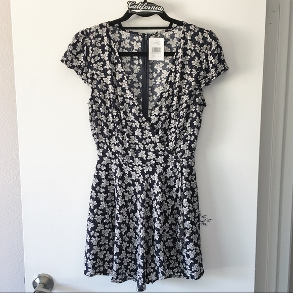 9f1d703c66bc BNWT navy and white floral print Hannah romper