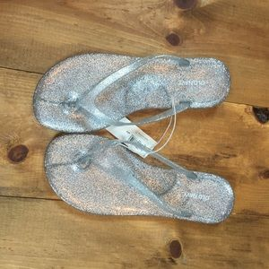 8f39f10e0 Old Navy · Silver glitter jelly flip flop sandals. NWT