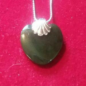 Jewelry - Serpentine shell pendant.
