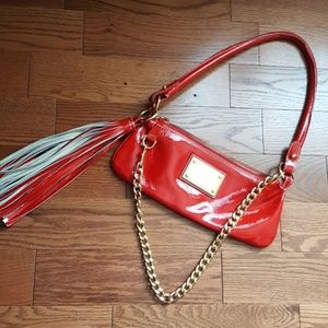 Guia's 1964 red leather bag.