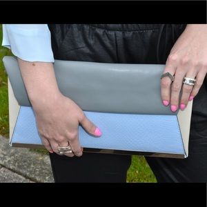 Blue color block clutch