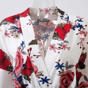 e9c13fc107e Free People Pants - White red floral ruffle wrap romper