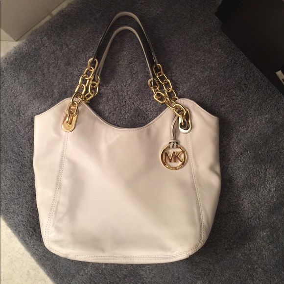 108309a5176d MK Vanilla medium Lilly bag with gold chain. M_59892d62f739bccccf0efda1.  Other Bags you may like. Michael Kors Purse