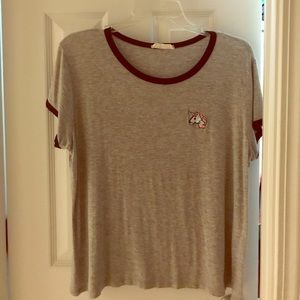 Gray t-shirt with unicorn patch on side
