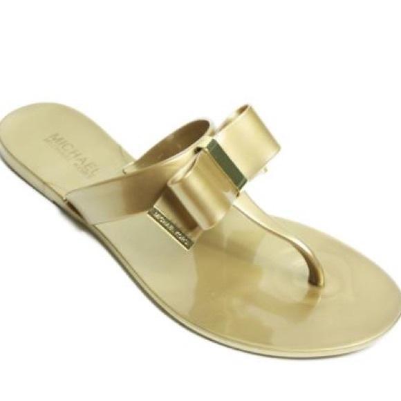 494c6409f38 NWOT Michael Kors Gold Kayden Bow Thing Sandal. M 598bcd1af739bc661501bcb5