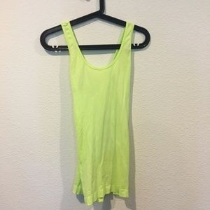 Light green workout tank with criss cross back