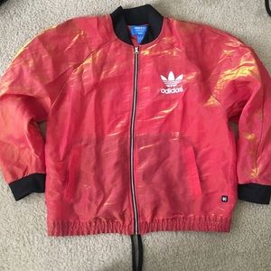 Red adidas jacket from the Rita ora collab.