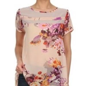 Woman's light pink floral blouse top