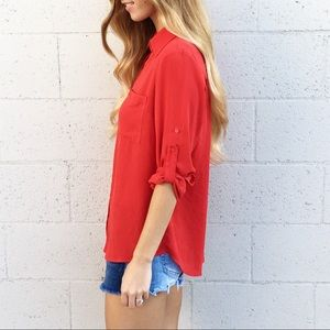 red button up blouse