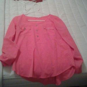 Sheer, long sleeve pink top.