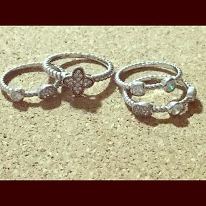 Jewelry - Set of 4 Sterling Silver stack rings with CZ's
