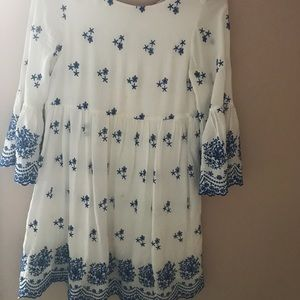 Scooped neck embroidered dress