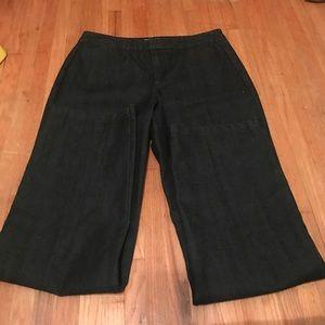 Dark wash denim slacks.