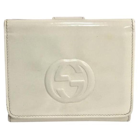 d76613beebf Gucci Handbags - Gucci white patent leather soho wallet