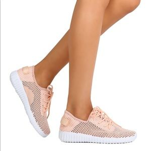 Ladies athletic light weight mesh sneakers. Pink