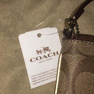 Coach Bags - BRAND NEW GOLD COACH CORNER ZIP WRISTLET