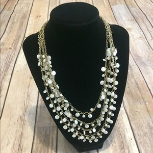 Mother of pearl/gold tone necklace