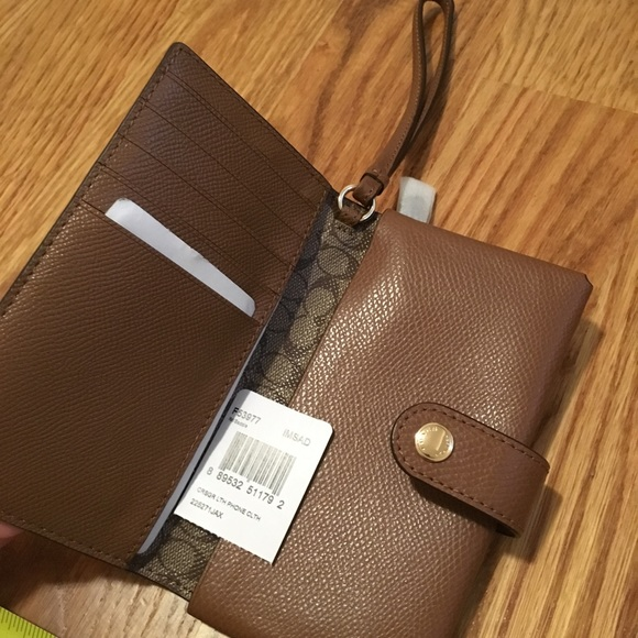 Coach Handbags - NWT Coach Phone Wallet in Brown Pebble Leather