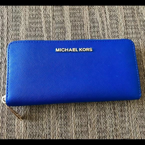 37a6dce00f74fb Michael Kors Continental Electric Blue Wallet. M_5999bc1cea3f369ddd0bd28a