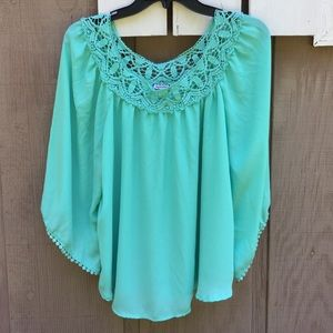Eyeshadow lace trimmed blouse