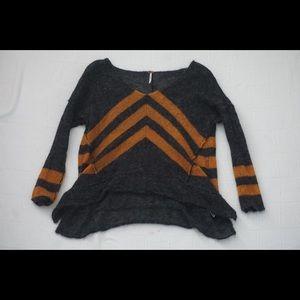 | FREE PEOPLE | orange and black wool sweater