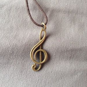 unique bronze necklace. Image of a treble clef.